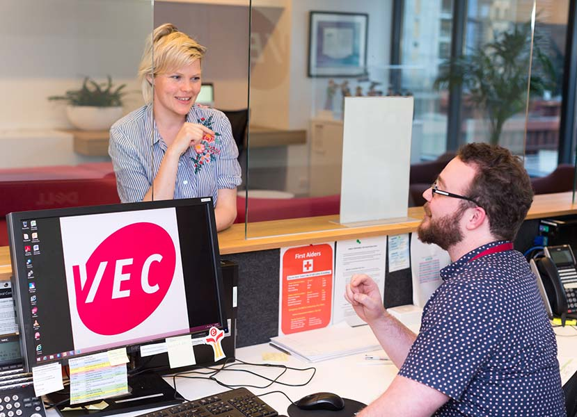 VEC receptionist talks to the member of the public